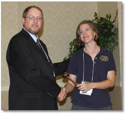 G. Yakman accepting the Presidential gavel for Virginia Technology Education Association 2010-2011 term.